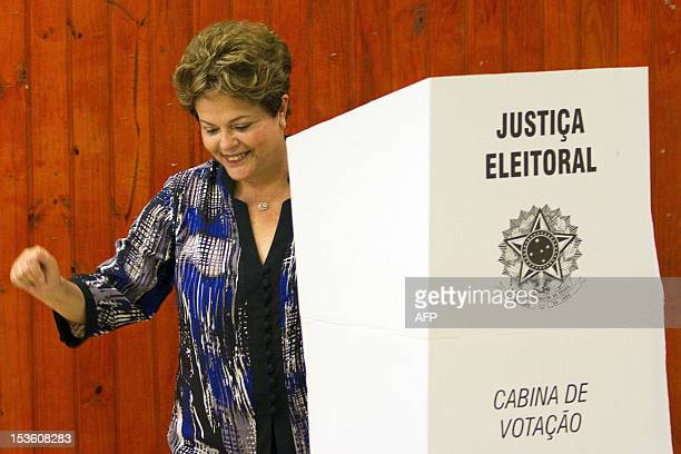 Brazilian President Dilma Rousseff smiles after casting her vote during nationawide municipal elections in Porto Alegre southern Brazil on October 7...