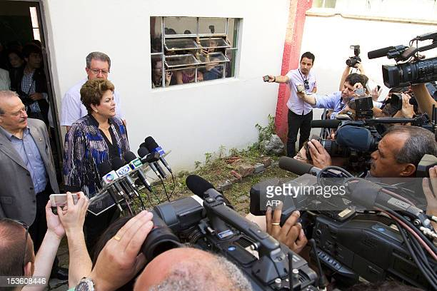 Brazilian President Dilma Rousseff speaks to the press at a polling station in Porto Alegre during nationawide municipal elections on October 7 2012...