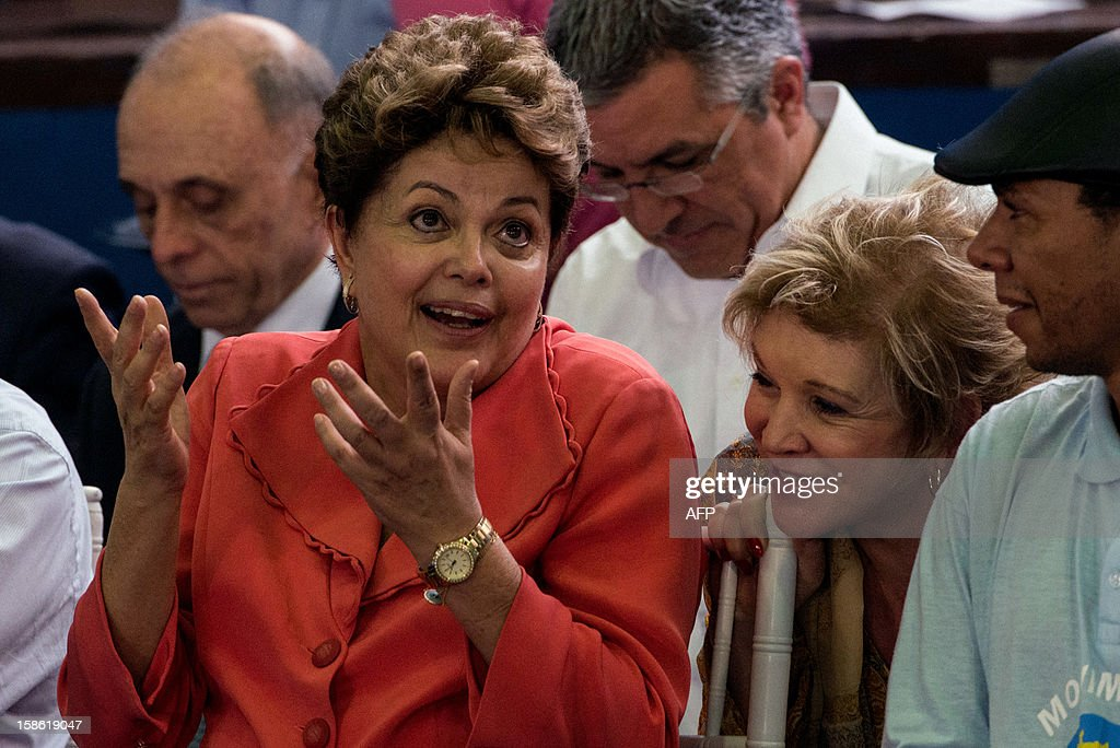 Brazilian President Dilma Rousseff (L) talks with Brazilian Minister of Culture Marta Suplicy (2nd R), during a Christmas celebration ceremony for homeless people, in Sao Paulo, Brazil, on December 21, 2012. Rousseff slammed all forms of violence against the homeless in Brazil during an address at a Christmas event with garbage collectors in Sao Paulo.