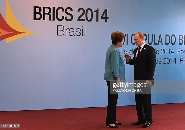 Brazilian President Dilma Rousseff talks with Russian President Vladimir Putin upon his arrival to the 6th BRICS summit in Fortaleza Brazil on July...