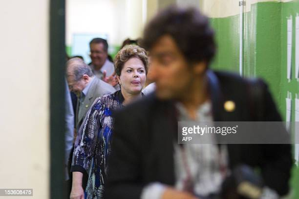 Brazilian President Dilma Rousseff walks at a polling station in Porto Alegre during nationawide municipal elections on October 7 2012 Brazilians...