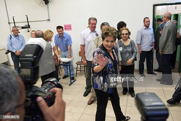 Brazilian President Dilma Rousseff waves after casting her vote at a polling station in Porto Alegre in the southern Brazilian state of Rio Grande do...