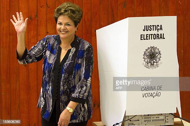 Brazilian President Dilma Rousseff waves after casting her vote during nationawide municipal elections in Porto Alegre southern Brazil on October 7...