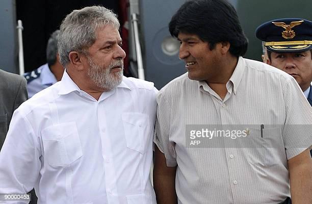 Brazilian President Luiz Ignacio Lula Da Silva is received by his Bolivian counterpart Evo Morales at the airport in Chimore 620 Km northwest of La...