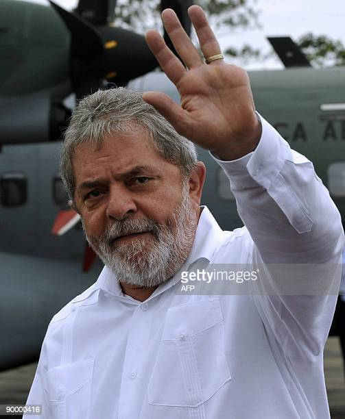Brazilian President Luiz Ignacio Lula Da Silva waves upon his arrival at the airport in Chimore 620 Km northwest of La Paz on August 22 2009 Lula Da...