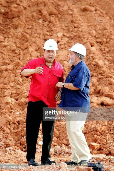 Brazilian President Luiz Inacio Lula da Silva and his Venezuelan counterpart Hugo Chavez talk during a visit to the Abreu e Lima Oil Refinery works...