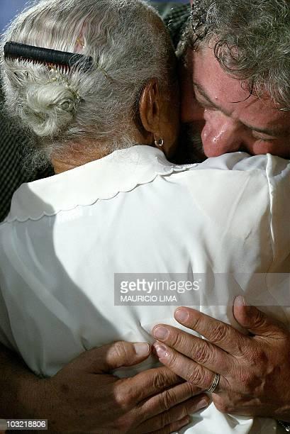 Brazilian President Luiz Inacio Lula da Silva embraces an elder in Sao Paulo Brazil during mass 01 May 2003 Luiz Inacio Lula da Silva presidente de...