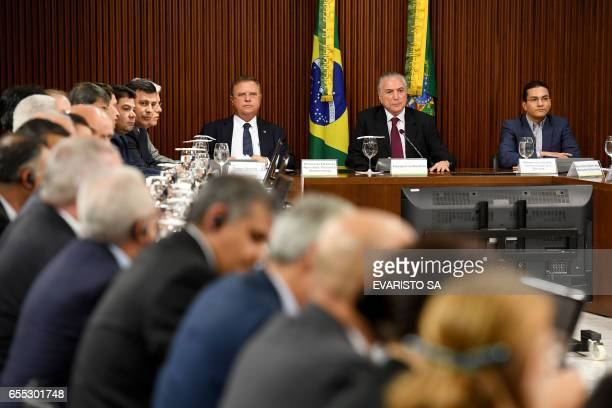 Brazilian President Michel Temer Agriculture Minister Blairo Maggi and Industry and Commerce Minister Marco Pereira meet with ambassadors from...