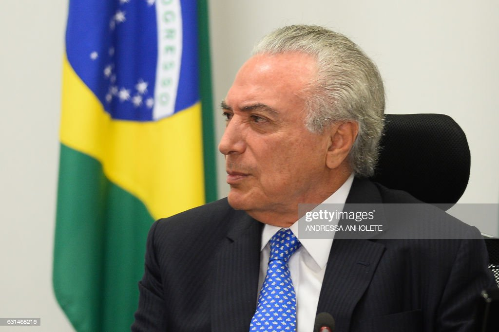 Brazilian President Michel Temer attends a meeting with the Infrastructure nucleus of the government at the Planalto Palace, in Brasilia on December 11, 2017. / AFP / ANDRESSA