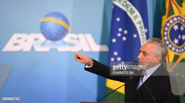 Brazilian President Michel Temer delivers a speech during the inauguration ceremony of the new Minister of Justice Torquato Jardim at the Planalto...