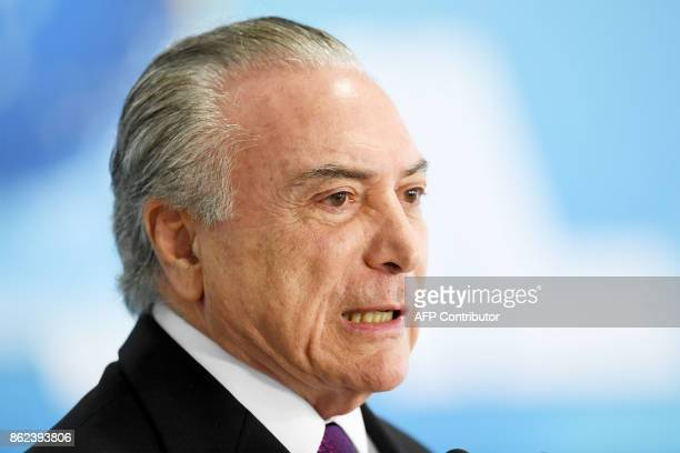 Brazilian President Michel Temer delivers a speech during the ceremony to grant the Order of Medical Merit an order conferred by the Brazilian...