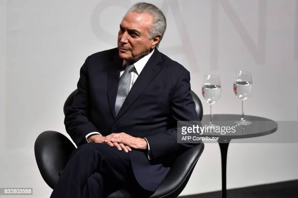 Brazilian President Michel Temer gestures during an Economic Forum in Sao Paulo Brazil on August 16 2017 International credit rating agency Standard...