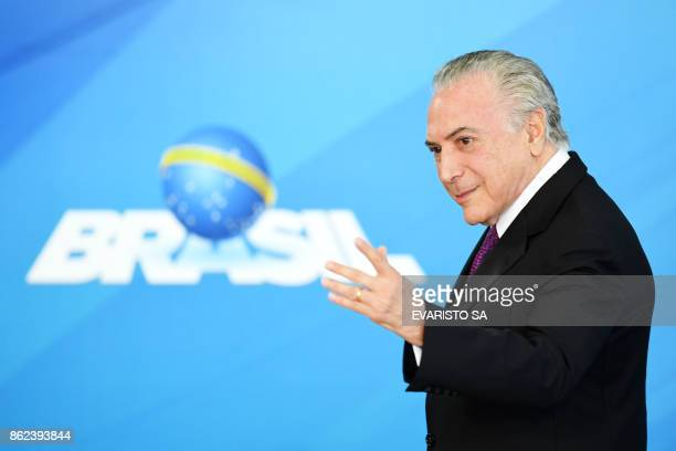 Brazilian President Michel Temer gestures during the ceremony to grant the Order of Medical Merit an order conferred by the Brazilian government on...