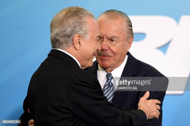 Brazilian President Michel Temer greets Former President Jose Sarney during the inauguration ceremony of the new Minister of Justice Torquato Jardim...