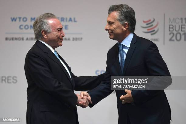 Brazilian President Michel Temer greets his Argentinian counterpart Mauricio Macri during the opening ceremony of the 11th Ministerial Conference of...