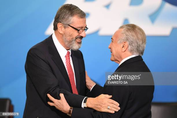 Brazilian President Michel Temer greets the new Minister of Justice Torquato Jardim during his inauguration ceremony at the Planalto Palace in...