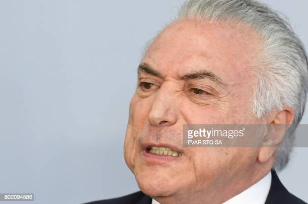 Brazilian President Michel Temer makes a statement rejecting a bribery charge against him at the Planalto Palace in Brasilia Brazil on June 27 2017...