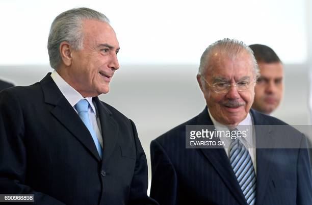 Brazilian President Michel Temer talks to former President Jose Sarney during inauguration ceremony of the new Minister of Justice Torquato Jardim at...