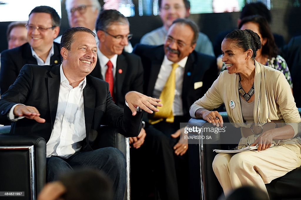 Brazilian presidential and vice presidential candidates for the Socialist Party (PSB) <a gi-track='captionPersonalityLinkClicked' href=/galleries/search?phrase=Eduardo+Campos&family=editorial&specificpeople=2666081 ng-click='$event.stopPropagation()'>Eduardo Campos</a> and Marina Silva respectively laugh during their candidacy pre-launch ceremony in Brasilia on April 14, 2014. AFP PHOTO/Evaristo SA