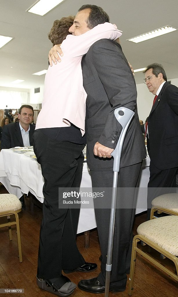 Brazilian presidential candidate Dilma Rousseff (L), of the Worker's Party (PT), wearing orthopedic boots due to a sprained ankle, greets equally debilitated Rio de Janeiro state governor Sergio Cabral during a campaign rally at the Rio de Janeiro Commerce Association on September 16, 2010 in Rio de Janeiro, Brazil.