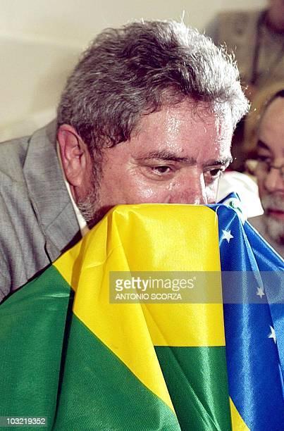 Brazilian Presidential candidate Luiz Inacio Lula da Silva kisses the Brazilian flag before casting his vote at a school in Sao Bernardo do Campo at...