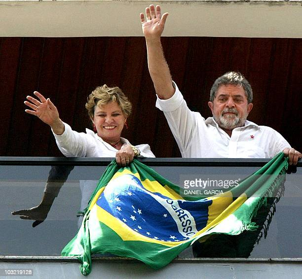 Brazilian presidential candidate Luiz Inacio Lula da Silva of the Worker's Party and his wife Marisa wave to supporters from his flat balcony 27...
