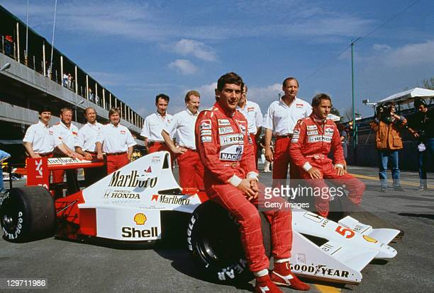 Brazilian racing driver Ayrton Senna and his Austrian teammate Gerhard Berger pose with the rest of the McLaren team at the Mexican Grand Prix at the...