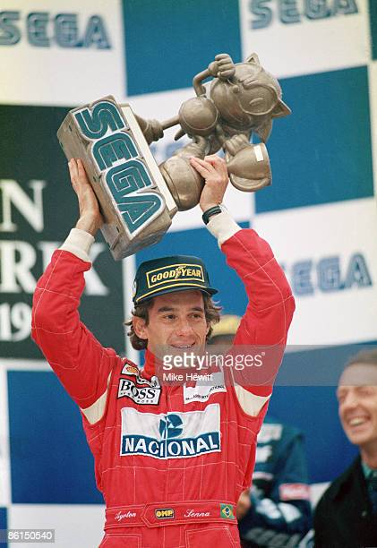 Brazilian racing driver Ayrton Senna with the trophy after winning the European Grand Prix at Donnington Park in a McLarenCosworth 11th April 1993