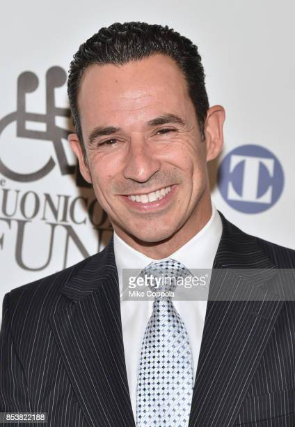 Brazilian racing driver Helio Castroneves attends the 32nd Annual Great Sports Legends Dinner To Benefit The Miami Project/Buoniconti Fund To Cure...