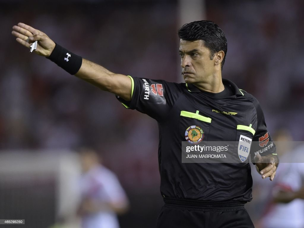 Brazilian referee <a gi-track='captionPersonalityLinkClicked' href=/galleries/search?phrase=Sandro+Ricci&family=editorial&specificpeople=9145717 ng-click='$event.stopPropagation()'>Sandro Ricci</a> gestures during the Copa Libertadores 2015 group 6 football match between Argentina's River Plate and Mexico's Tigres at the 'Monumental' stadium in Buenos Aires, Argentina, on March 5, 2015. AFP PHOTO / JUAN MABROMATA