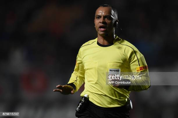 Brazilian referee Wilton Pereira Sampaio conducts the Copa Libertadores round of 16 second leg football match between Argentina's team San Lorenzo...
