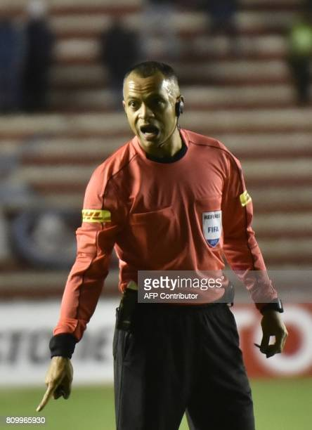 Brazilian referee Wilton Sampaio gestures during the Copa Libertadores football match betweenThe Strongest of Bolivia and Argentina's Lanus at...