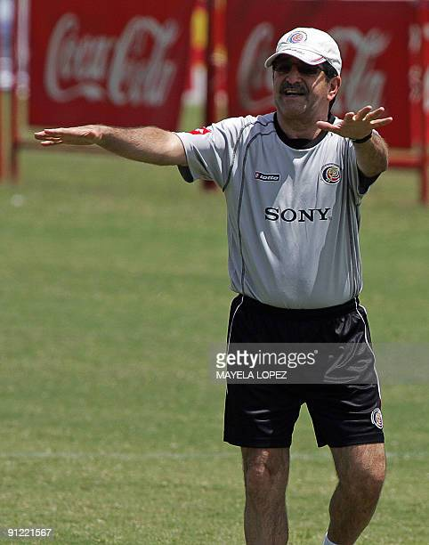 Brazilian Rene Simoes coach of Costa Rica's national football team talks to his players September 28 during his first training session with them in...