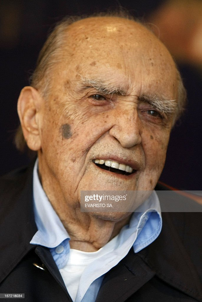 Brazilian renown architect and urbanist 101-year-old <a gi-track='captionPersonalityLinkClicked' href=/galleries/search?phrase=Oscar+Niemeyer&family=editorial&specificpeople=161539 ng-click='$event.stopPropagation()'>Oscar Niemeyer</a>, designer of Brasilia, smiles during a meeting with Brazil's President Luiz Inacio Lula da Silva at Planalto Palace on December 11, 2008 in Brasilia. Niemeyer has been entrusted with the refurbishment of the Planalto Palace to be initiated in 2009. AFP PHOTO/Evaristo SA