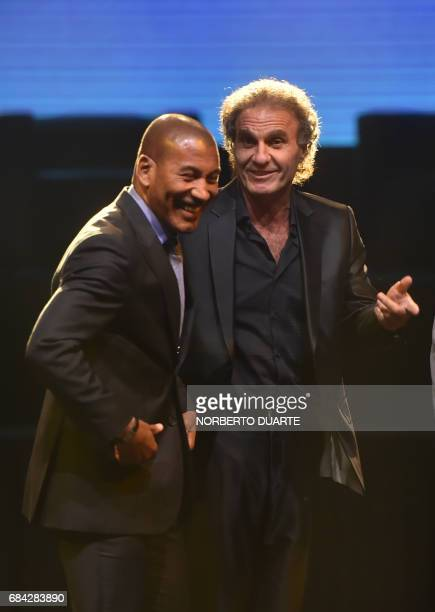 Brazilian retired footballer Mauro Silva and Argentinian former footballers Oscar Ruggeri joke during a meeting at the Conmebol's headquarters in...