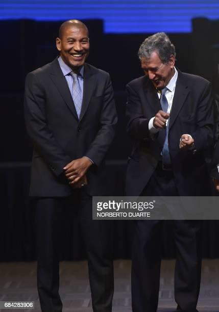 Brazilian retired footballer Mauro Silva and Brazilian former football manager Carlos Alberto Parreira joke during a meeting at the Conmebol's...