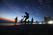Brazilian revelers play soccer at sunset during Carnival celebrations along Ipanema beach on February 18 2012 in Rio de Janiero Brazil Carnival is...