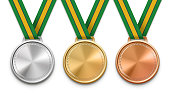 Three winning medals with Brazilian flag ribbon.