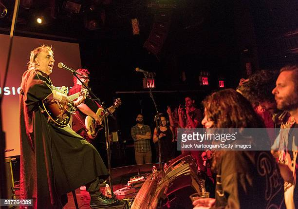 Brazilian Rock musician and composer Sergio Dias plays guitar as he leads his band Os Mutantes in a World Music Institute concert to inaugurate their...
