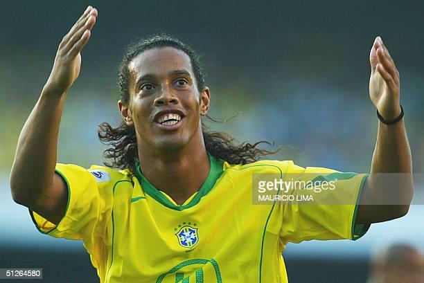 Brazilian Ronaldinho Gaucho celebrates his goal against Bolivia at the Morumbi stadium in Sao Paulo 05 September 2004 for the FIFA World Cup Germany...