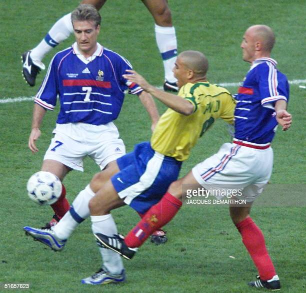 Brazilian Ronaldo is challenged by French Didier Deschamps and Frank Leboeuf 12 July at the Stade de France in SaintDenis during the 1998 World Cup...