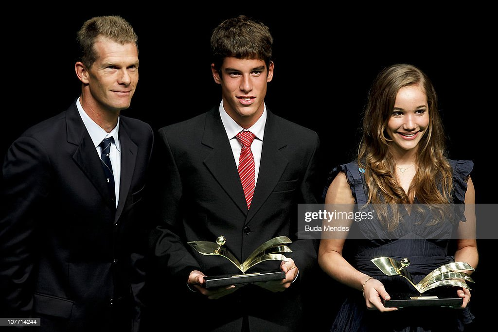 Brazilian sailing medalist <a gi-track='captionPersonalityLinkClicked' href=/galleries/search?phrase=Robert+Scheidt&family=editorial&specificpeople=227306 ng-click='$event.stopPropagation()'>Robert Scheidt</a> awards college athletes Vitor Nascimento Santos and Emanuelle Lopes e Lima during the ceremony of Brazil's Olympics award Premio Brasil Olimpico at the MAM Theater on December 20, 2010 in Rio de Janeiro, Brazil.