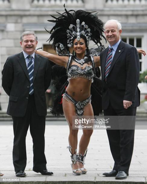 Brazilian samba dancer Kelly Baldonado poses with Speakers of the Dail and Senate Brendan Howlin TD and Senator Pat Moylan on the Plinth at Leinster...