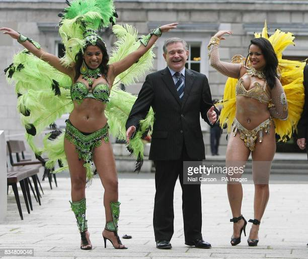 Brazilian samba dancers Selma Brandao and Vanessa Coelho pose with Labour TD Brendan Howlin on the Plinth at Leinster House to remind people Leinster...