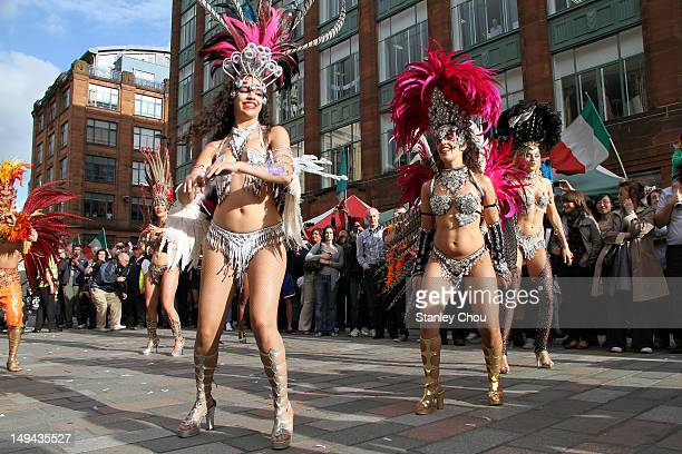 Brazilian samba girls dance on the street of Glasgow city in a procession ceremony conjunction with the 2012 London Olympic Games opening ceremony at...