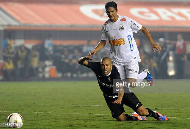Brazilian Santos player Durval Ramos vies for the ball with Emerson Shiek of Brazilian's Corinthians during their Copa Libertadores football...
