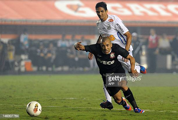 Brazilian Santos player Durval vies for the ball with Emerson Shiek of Brazilian's Corinthians during their Copa Libertadores football semifinal...