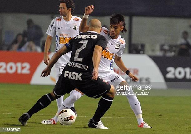 Brazilian Santos' player Neymar vies for the ball with Alessandro of Brazilian Corinthians during their Copa Libertadores first leg semifinal...