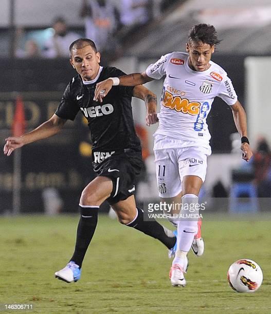 Brazilian Santos' player Neymar vies for the ball with Fabio Santos of Brazilian Corinthians during their Copa Libertadores first leg semifinal...