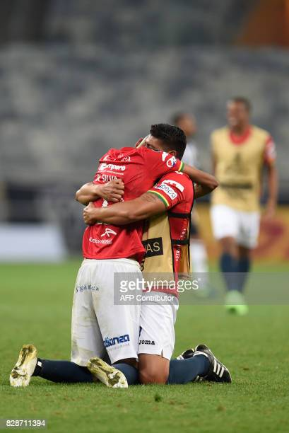 Brazilian Serginho of Bolivia's Jorge Wilstermann celebrates with a teammate after his team qualified in the end of a Copa Libertadores football...